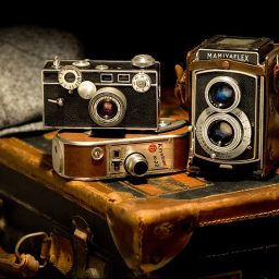 three_old_cameras